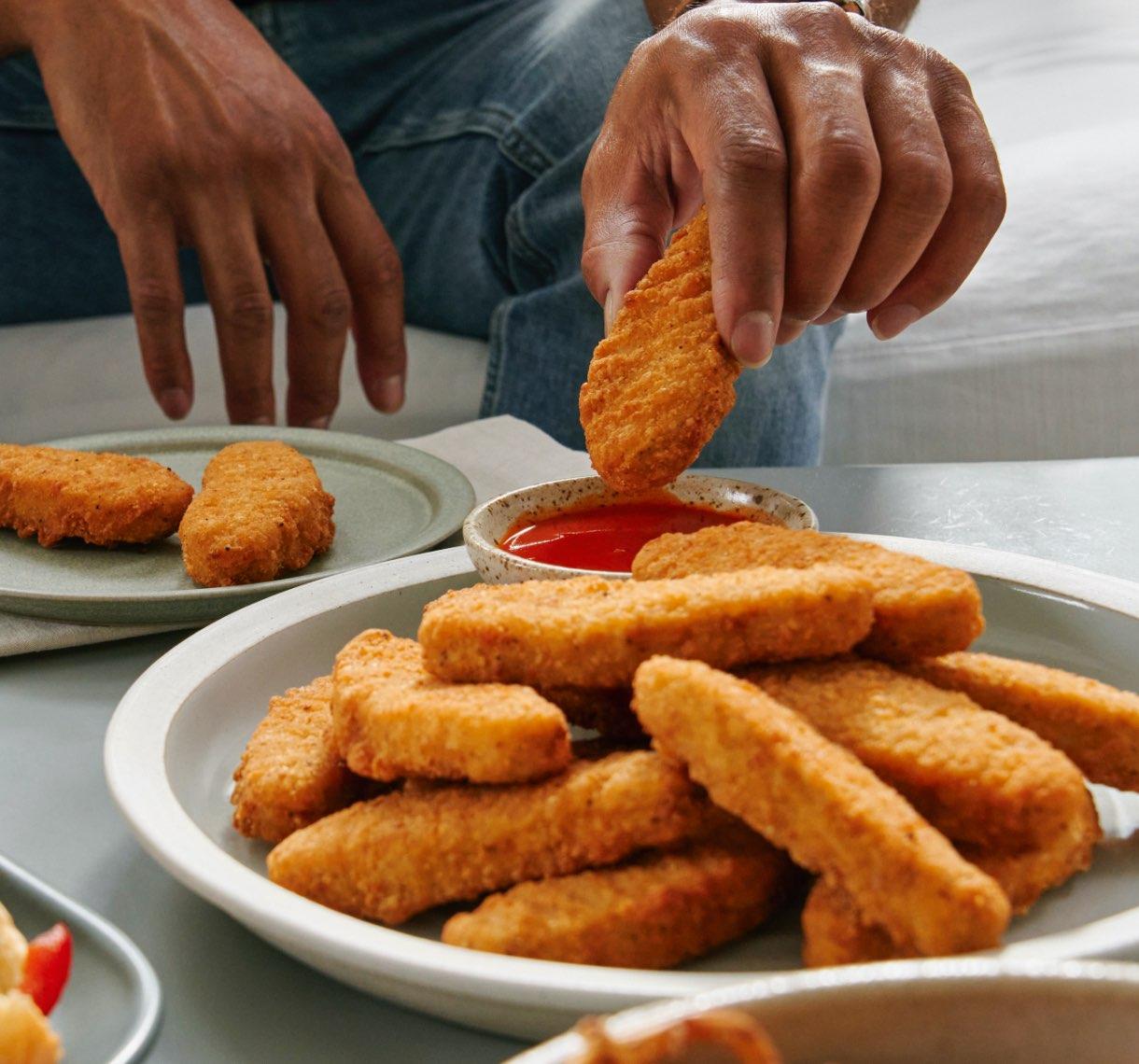 Beyond Chicken Tenders being dipped in ketchup
